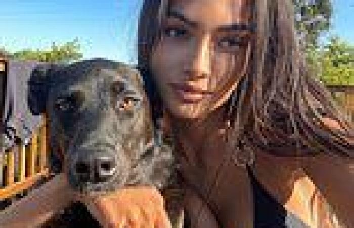 Victoria's Secret model Kelly Gale shows off her ample cleavage in a string ...