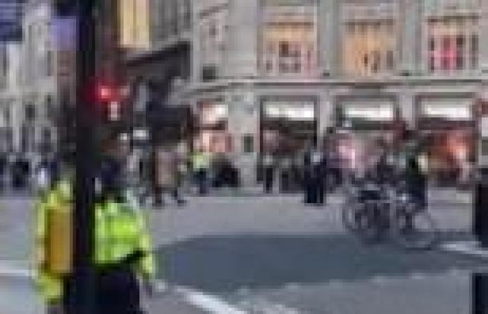 Middle-aged man fights for his life after being stabbed in the middle of Oxford ...
