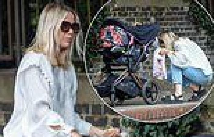 Kate Lawler in mom jeans and floaty cream top with baby Noa for mother-daughter ...