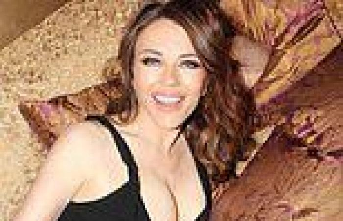 Elizabeth Hurley, 56, puts on busty display in a plunging black dress for a ...