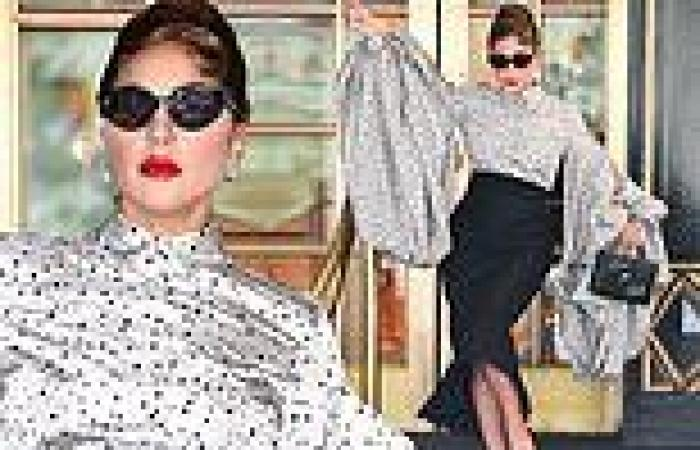 Lady Gaga exudes glamour in a dramatic puff sleeved blouse while exiting her ...