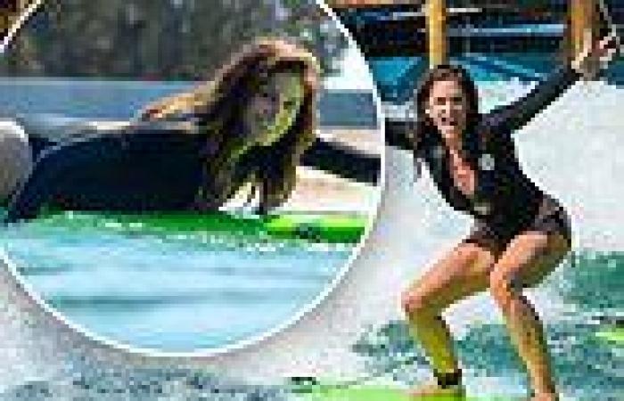 Cindy Crawford puts her bikini body on display as she hits the surf