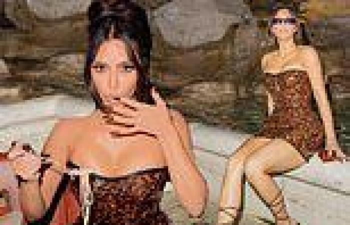Kim Kardashian dines on pasta at the Trevi restaurant in Rome as her Italian ...