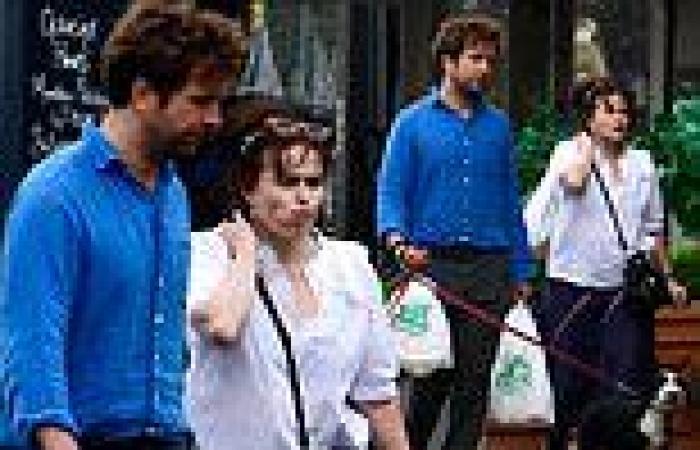 Helena Bonham Carter cuts a casual figure in a white shirt on a dog walk with ...