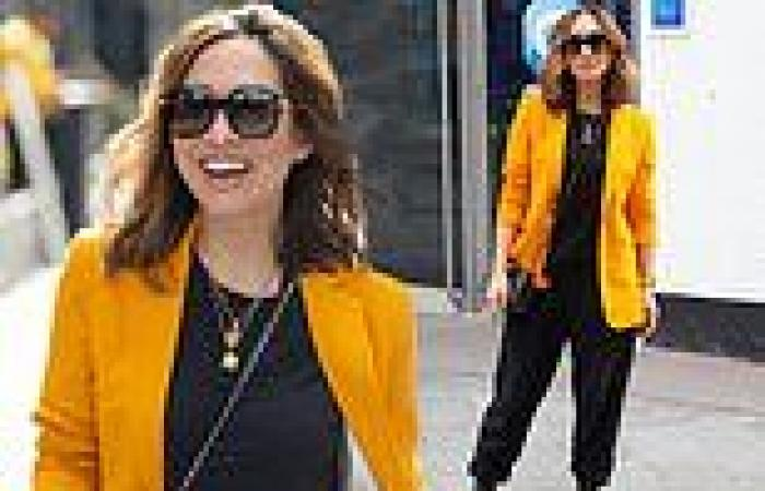 Myleene Klass turns heads in bright orange blazer and black tracksuit co-ord