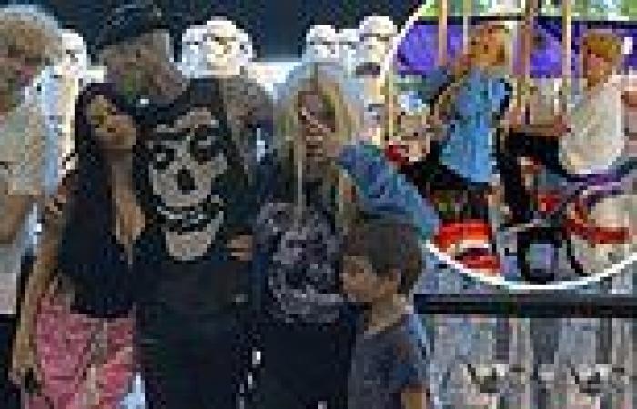 Travis Barker shares a sweet kiss with Kourtney Kardashian at Disneyland on a ...