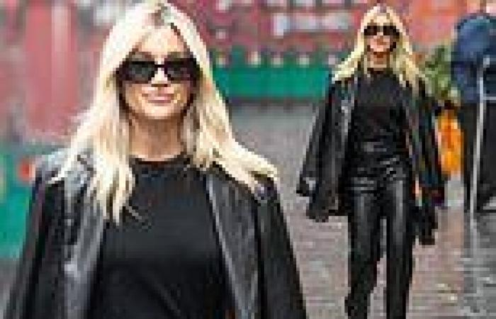 Ashley Roberts suits up in a chic leather blazer and matching trousers
