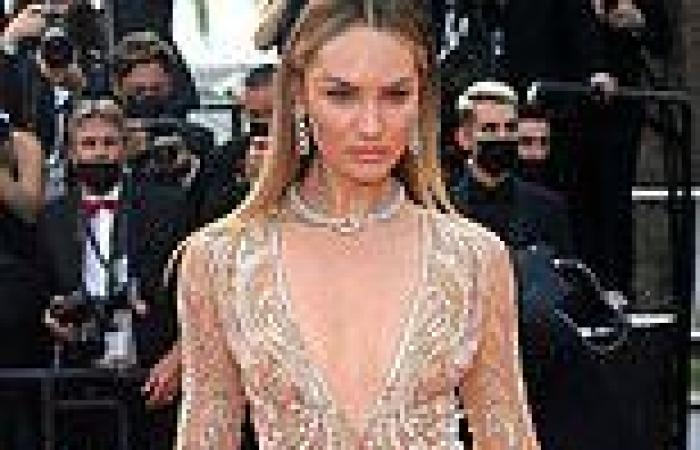 Cannes: Candice Swanepoel wears plunging nude fringed jumpsuit to Annette
