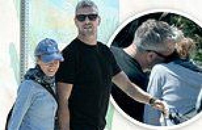 Renee Zellweger and new beau Ant Anstead share a KISS during a romantic bike ...