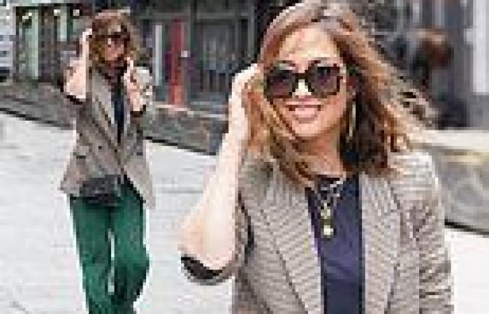 Myleene Klass displays her trendy sense of style in a tweed blazer and green ...