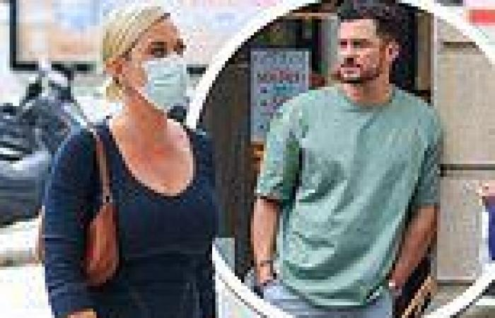 Katy Perry slips into a denim midi dress as she goes shopping in Paris with ...