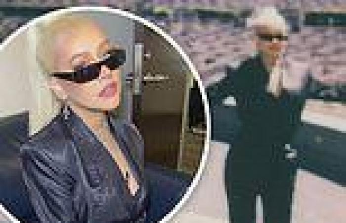 Christina Aguilera is chic in black satin as she preps for concerts at historic ...