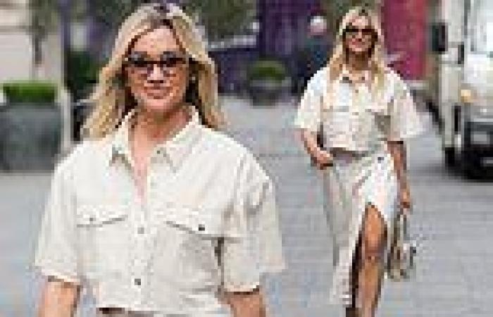 Ashley Roberts cuts a stylish figure in a bleached denim midi and jacket
