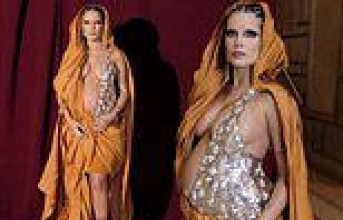 Halsey is a masterpiece as she wanders around the Met in a belly-baring silver ...