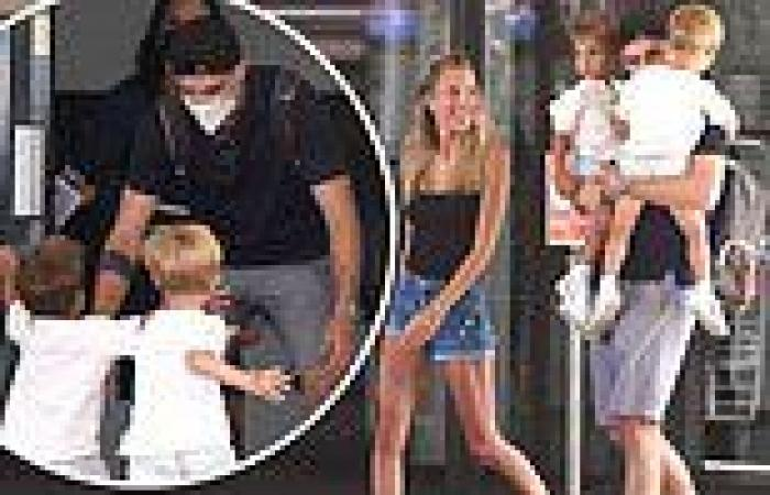 Spain's Alvaro Morata is greeted by his adoring wife and kids as he arrives in ...