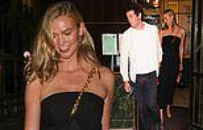 Karlie Kloss looks chic in a bandeau black dress as she holds hands with her ...