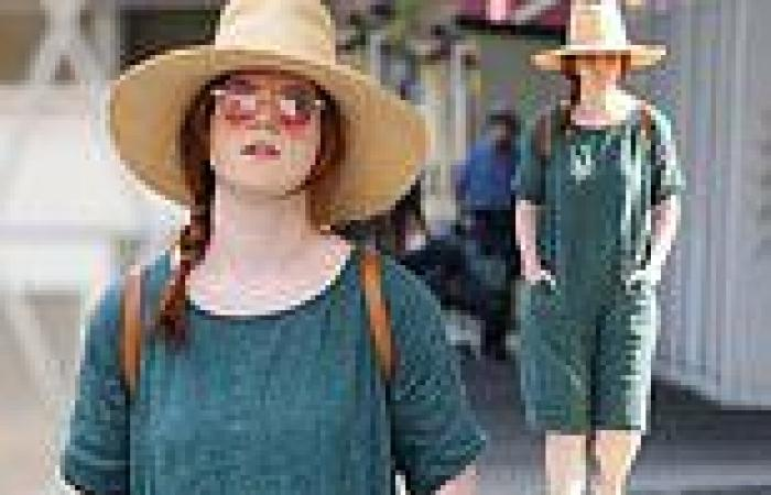 Rosie Leslie cuts a casual figure in a teal dress as she takes a stroll through ...