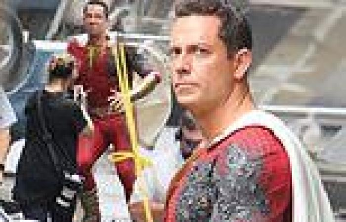 Zachary Levi sports a slightly-charred superhero suit on the set of Shazam: ...
