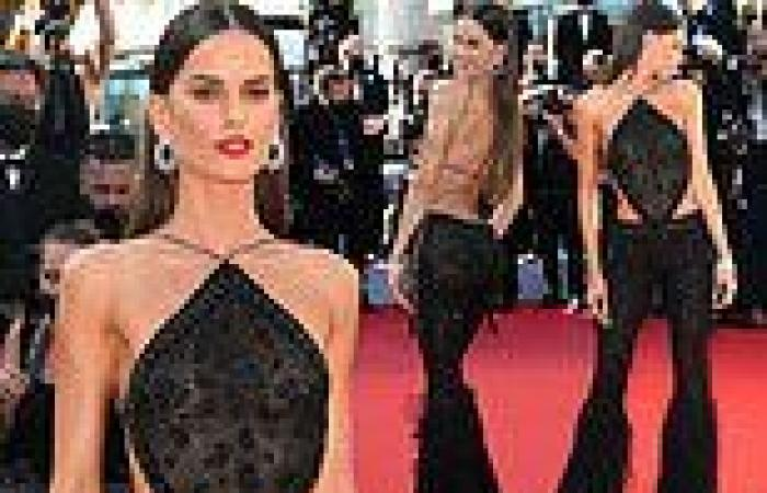 Izabel Goulart dazzles in a black glitzy backless top and feathered trousers in ...