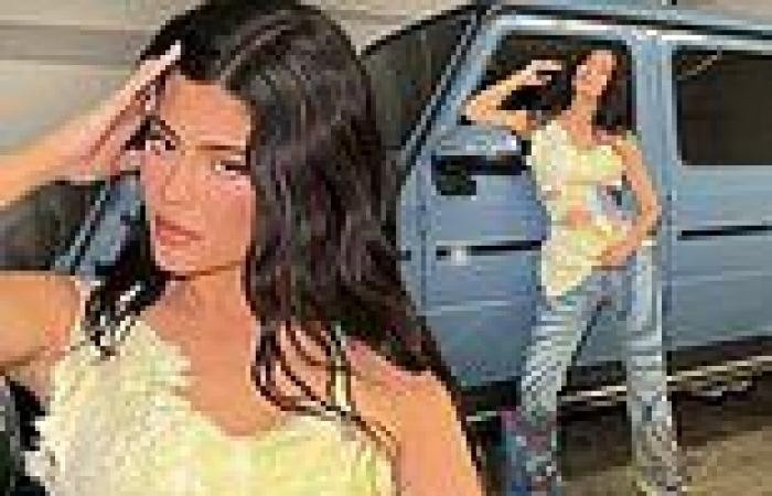 Kylie Jenner revs engines as she leans against her custom Mercedes Benz Wagon ...