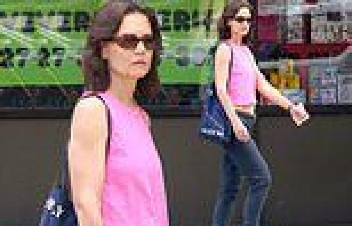 Katie Holmes wows as she flashes her abs in bright pink top
