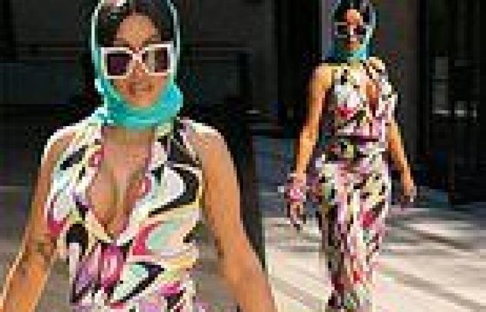 Cardi B puts on a busty display in a colorful patterned jumpsuit that hides her ...
