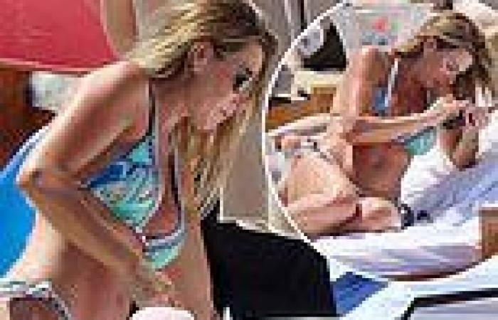 John Terry's wife Toni, 40, looks incredible in aqua blue bikini
