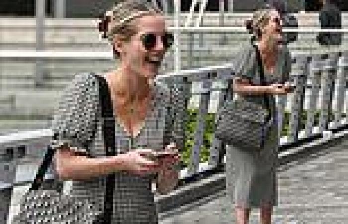 Helen Flanagan wows in a stylish monochrome gingham dress for stroll through ...