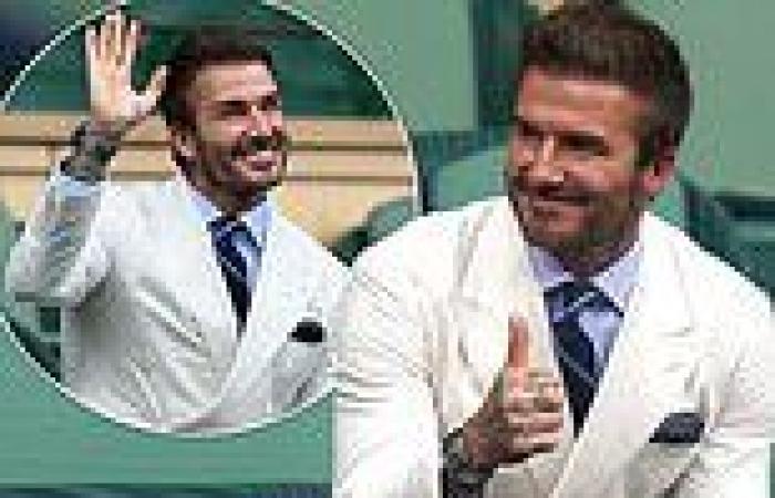 David Beckham waves and gives a thumbs up to fans at Wimbledon men's semi-final
