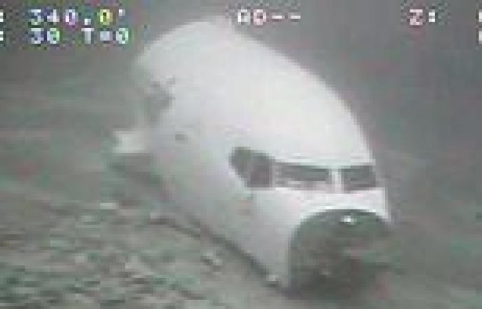 Haunting photos show underwater wreckage of Boeing cargo plane off