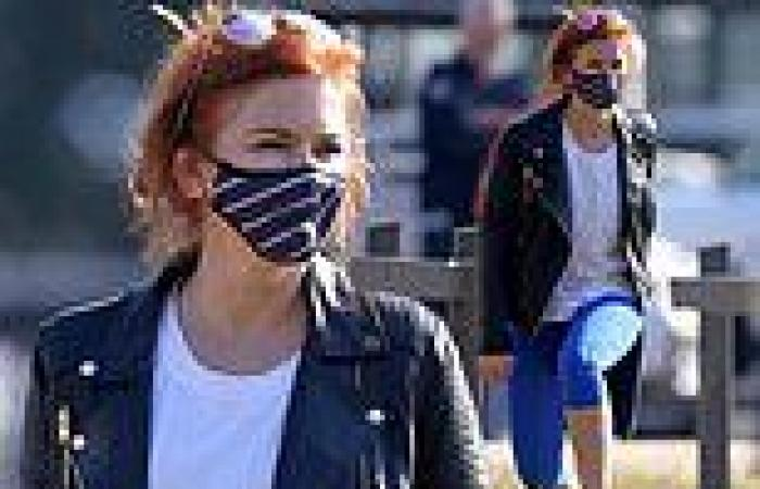 Isla Fisher exercises in a leather jacket and leggings as Sydney's lockdown ...
