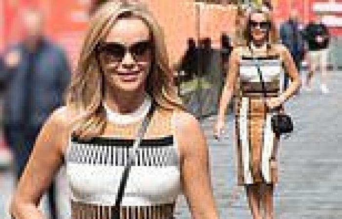 Amanda Holden looks classy in a figure-hugging dress as she steps out at Heart ...