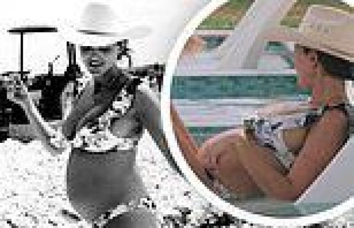 The Hills star Kaitlynn Carter shows off her baby bump while in a bikini