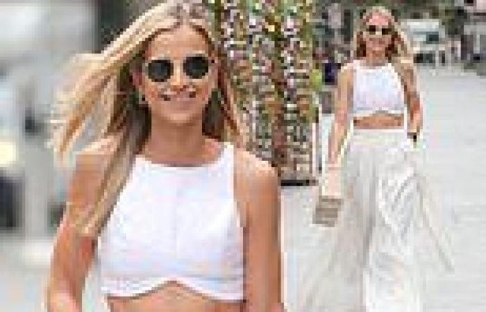 Vogue Williams manifests her incredible midriff in a glam white ensemble as she ...