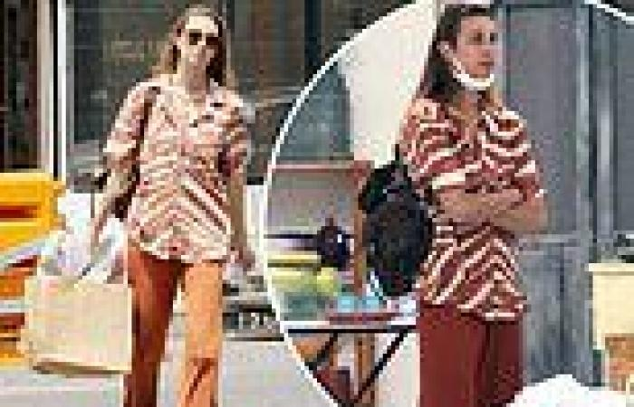 Whitney Port goes shopping in LA in striking brown and white blouse and brown ...