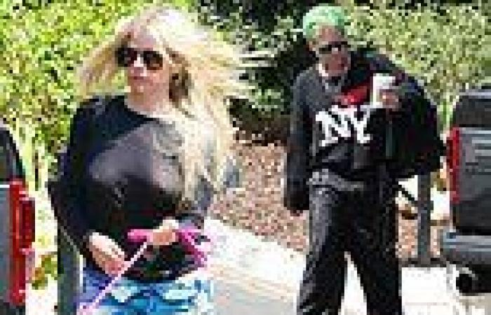 Avril Lavigne goes braless beneath a see-through top as she and Mod Sun head to ...
