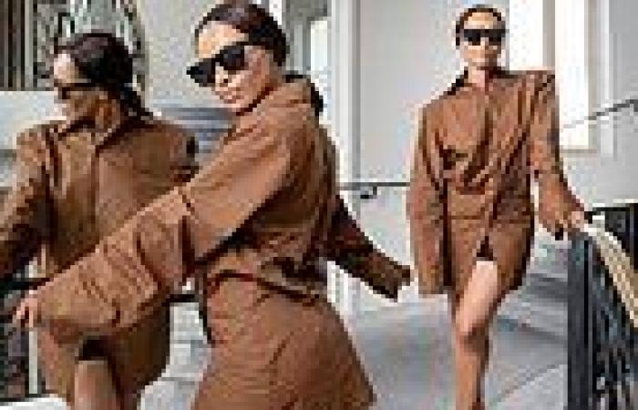 Kat Graham puts on leggy display in oversized shirt dress as she excitedly ...