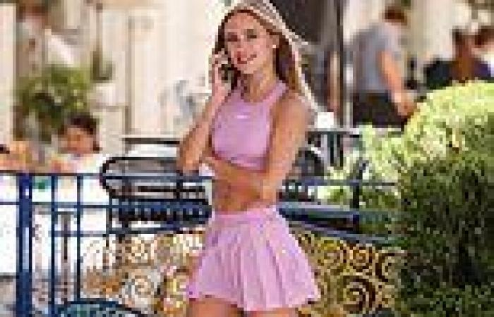Kimberley Garner changes from a skimpy pink tennis outfit to a long silk blouse ...