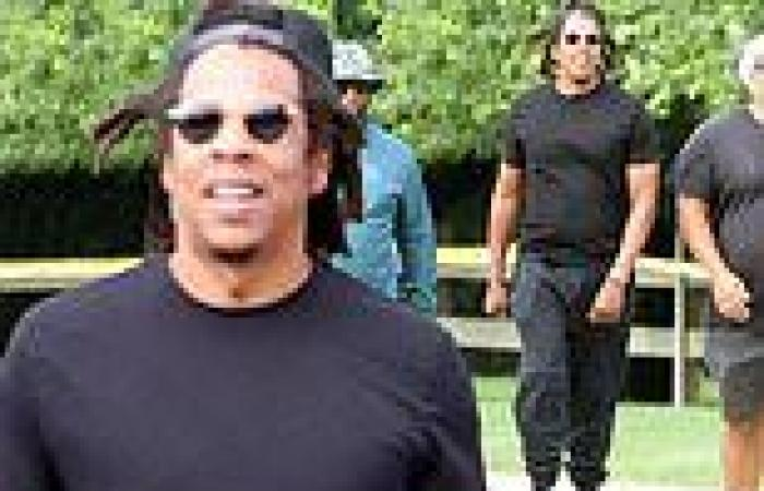 Jay-Z shows off his toned biceps as he steps out for some exercise with his ...