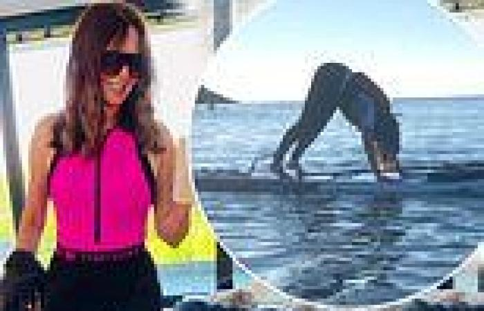 Carol Vorderman, 60, shows off her youthful figure in neon pink wetsuit
