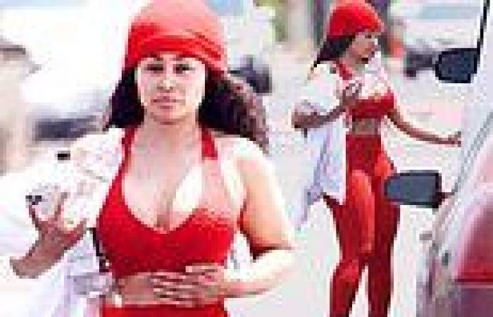 Blac Chyna flaunts her famous curves in a red crop top and matching leggings as ...
