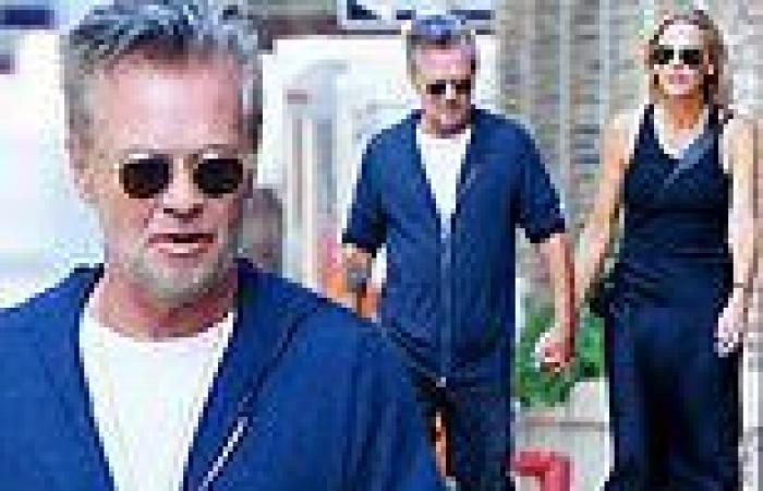 John Mellencamp, 69, holds hands with his new girlfriend Natasha Barrett, 46, ...