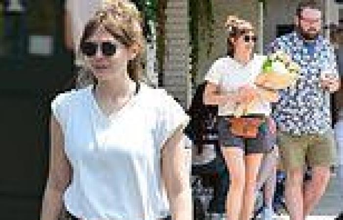 Elizabeth Olsen cuts a casual figure in athletic shorts and a T-shirt in L.A.
