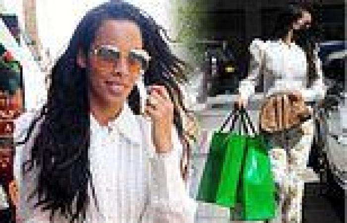 Rochelle Humes looks summery in a floral trousers and white shirt