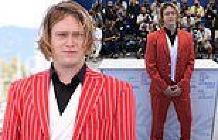 Caleb Landry Jones cuts a striking figure in a red pinstripe suit at the Nitram ...