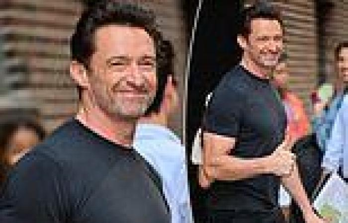 Hugh Jackman shows off his bulging biceps ahead of a TV appearance in New York