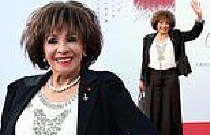 Dame Shirley Bassey, 84, is chic in a black trouser suit at the Red Cross ...