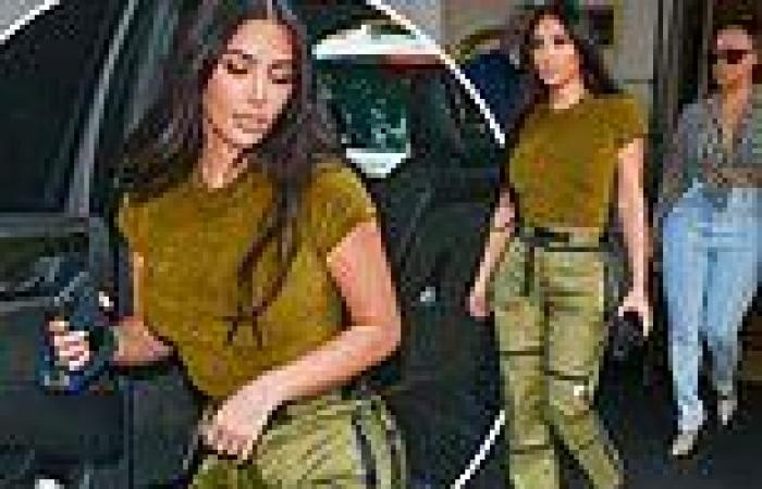 Kim Kardashian flashes a hint of her flat midriff in green crop top and ...