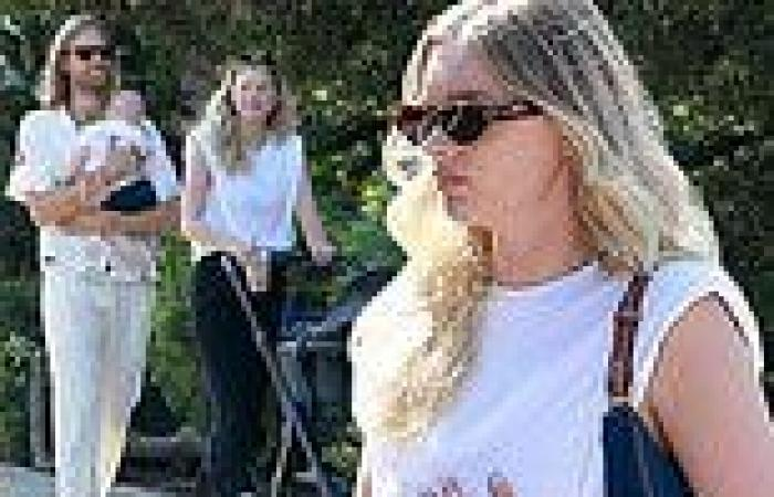 Elsa Hosk steps out for family stroll with longtime love Tom Daly who cradles ...