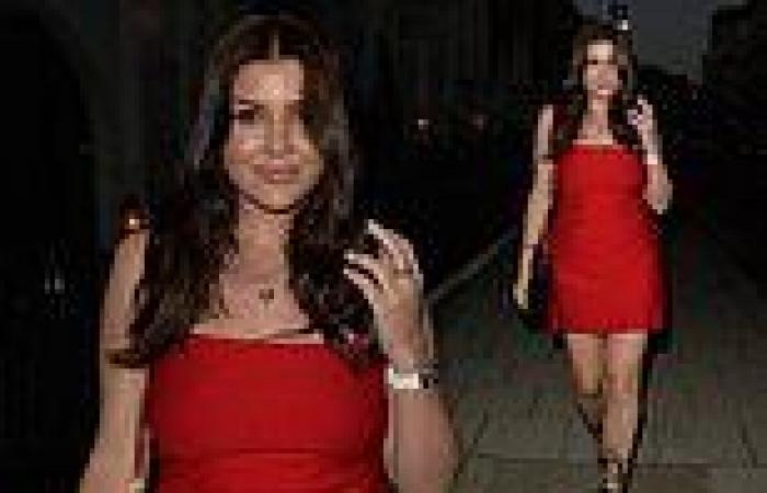 Imogen Thomas flaunts her endless pins in a thigh-skimming red mini dress
